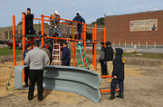 Volunteers turn out to build Muskegon Heights school playground