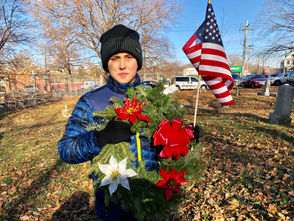 STATEN ISLAND, N.Y. -- The frosty 28-degree weather did not deter members of the Verrazano Kiwanis Club and scores of supporters from gathering at Lake Cemetery in Graniteville on Saturday morning for the group's inaugural Veterans Wreath Project. Fresh Christmas wreaths, donated by Al Ruggerio of Richmondtown Garden Center, were laid carefully by volunteers on the graves of veterans, paying homage to the men and women who paid the ultimate sacrifice for our freedom. Each grave was also adorned with an American flag, donated by the veterans from the American Legion's Kells Grennie Post, who were present at the event.