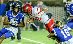 Alabama's Amontae Spivey of Central-Phenix City is stopped by Mississippi's Jalen Jordan of Lake Cormorant during the Alabama-Mississippi All-Star football game at the Cramton Bowl in Montgomery, Ala., Monday, Dec. 17, 2018. (Dennis Victory | preps@al.com) Dennis Victory