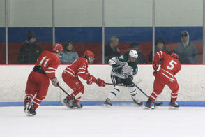 Two goals from Matthew Kowal lead the Minnechaug ice hockey team to its first win of the season over East Longmeadow, 2-1. (DOUG STEINBOCK/ MASSLIVE)