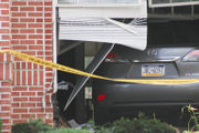 Car crashes through wall, windows and traps woman in office (PHOTOS)