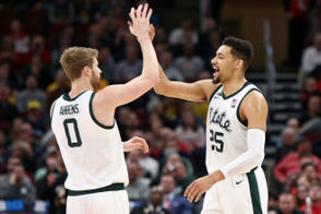 Michigan State forward Kenny Goins (25) high-fives guard Kyle Ahrens (0) after a 3-pointer during the second half of their Big Ten Tournament quarterfinal game against Ohio State at the United Center in Chicago on Friday, March 15, 2019. Michigan State won the game, 77-70. (Mike Mulholland | MLive.com)