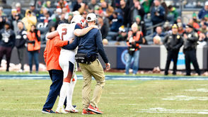 It was the deja vu no one associated with Syracuse football wanted to feel.  The all-too-familiar image of senior quarterback Eric Dungey being helped off the field with a game-ending injury.  The unfortunate memories were stirred again after Dungey reached for his lower-right back then went down to the Yankee Stadium turf like a sack of bricks after a running play midway through the first quarter against Notre Dame. He went into the locker room and never returned. Reports after the game indicated that Dungey could not walk to the team bus on his own power.  The injury adds another bad memory of Dungey having to exit a Syracuse game. There was the brutal hit to the head vs. Central Michigan in his freshman year at the Carrier Dome. Dungey suffered a concussion on the play.  His sophomore season in 2016 ended after taking a hit near the head at Clemson, a 54-0 loss for Syracuse. He missed the final three games of that season. Dungey suffered a broken foot last season against Florida State, keeping him out of action for the final three games of the 2017 season.  Before exiting, Dungey completed 1-of-4 passes for 10 yards and an interception against the Irish.  His mobility was missed as the Notre Dame defense overwhelmed the Syracuse offensive line throughout the game, compiling six sacks on the day.  Now we wait to see the severity of Dungey's injury and if the last image Orange fans will see of him on a football field will be of being helped off it.