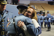 Son of Sgt. Douglas Weddleton, who was killed in line of duty, among 174 new Massachusetts State Police troopers who earned a badge today