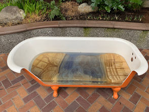 Tub(Time) by the Tubsters of Berkeley, California: A repurposed bathtub, conceived to promote water conservation, has layers of sustainably harvested wood arranged to represent an urban landscape and the watershed region.