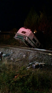 Woman blows stop sign, flips brakeless motorhome onto railroad tracks, police say