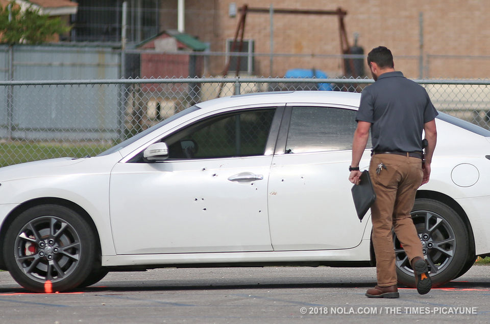 JPSO investigates the scene of a triple shooting at the Lincolnshire Walking Trail in Marrero on May 27, 2018.
