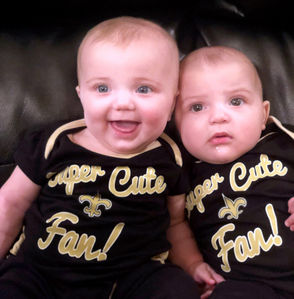 """""""Meet the newest members of The Who Dat Nation: Luna (on the left) and Gaia (on the right)!! Both are big fans of Brees and Kamara. Luna loves (to) provide commentary and Gaia leans into the screen when they line up to snap the ball. And as you can see they were thrilled when the Saints beat the Eagles last week. 5 months old and they're already proving to be two of the loudest and proudest fans around!!"""" -- Monique LaFonta (Luna and Gaia's mommy)"""