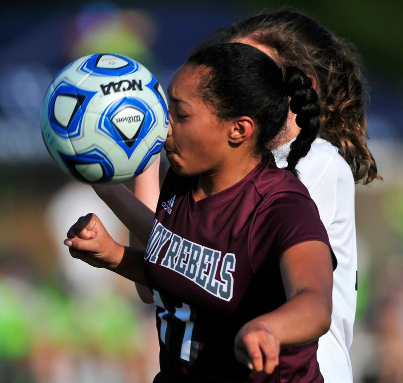 <p>West Morgan's Brittany Campbell takes a ball to the nose in the AHSAA