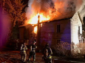 A centuries-old home in the 1100 block of Hope-Bridgeville Road in Hope Township is heavily damaged by fire the evening of Dec. 10, 2018.
