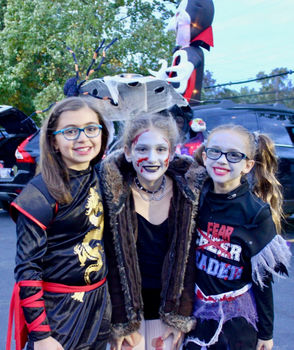 St. Patrick's students, from left, Angelina Panepinto, Misty Spano and Addison Abrahamsen smile for the camera at their school's Trunk or Treat event. (Courtesy/Tara Kelly)