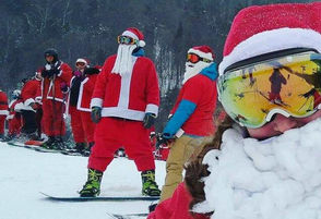 Christmas spirit was in the air at Whiteface Mountain on Sunday, where 564 Santa Clauses bombed down the slopes of the biggest ski mountain in Upstate New York. Riders dressed as Mr. and Mrs. Claus could ski free all day, they just needed to participate in a group photo for the event. The event also collected new or gently-used winter coats and toys to donate for the holidays. The hundreds of Santas speckled the mountainside with color. Take a look at the festivities in the photos below.