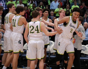 Mountain Brook's Trendon Watford is congratulated by teammates after being named MVP against Baker during the Class 7A AHSAA Basketball Championship game at the BJCC Legacy Arena in Birmingham, Ala., Saturday, March 2, 2019. (Dennis Victory | preps@al.com) Dennis Victory