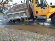 Springfield DPW truck swallowed by sinkhole after road collapses