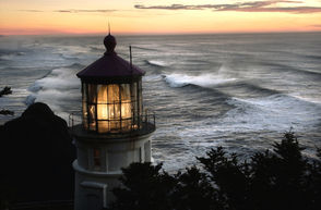 The Heceta Head Lighthouse, pictured at sunset in winter 2003. The red-roofed lighthouse perched at the center of a sloping headland is one of the most iconic images on the Oregon coast. Just north of Florence, and a mile from the popular Sea Lion Caves, the Heceta Head Lighthouse has endeared itself to generations of visitors, surviving more than a century on the rocky ocean shore.  This month marks the 125th anniversary of the lighting of Heceta Head Lighthouse, celebrating a history that has seen the beacon's role shift from maritime necessity to antiquated technology, finally preserved and maintained as a tourist attraction.  The Heceta Lighthouse Bed and Breakfast, privately operated in the old keeper's house, will host a variety of celebrations in March, April and May, including a speaker series, teas, a spring hike and a birthday party for the lighthouse March 30.