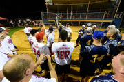 More than $1K raised as police play firefighters in softball (PHOTOS)