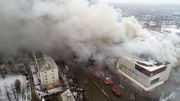 Russian fire's death toll rises to 64, many of them children at shopping mall