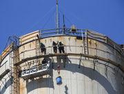 Work to dismantle B.C. Cobb's 650-foot-tall smokestack begins