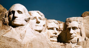 Mount Rushmore features four presidents (from left to right) carved out of a granite rock face in the Black Hills of South Dakota: George Washington, the nation's first president, serving 1787 - 1797: Thomas Jefferson, nation's third president, serving 1801 - 1809; Theodore Roosevelt, nation's 26th president, serving 1901 - 1909; and Abraham Lincoln, nation's 16th president, serving 1861-1865.     President's Day is celebrated on the third Monday in February.  It was originally established in 1885 in recognition of President George Washington.
