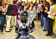 Syracuse school community embraces annual Halloween parade