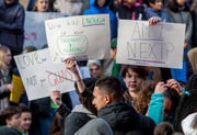 'Am I Next?' and other student-made signs seen during National School Walkout