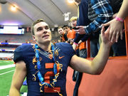 Photos: Syracuse football's Eric Dungey takes victory lap around dome