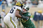 Overheard outside Michigan State's locker room: Living with loss for a year and no QB controversy