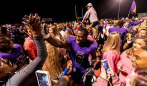 Hueytown's Roydell Williams celebrates with fans after clinching a regional championship at the McAdory at Hueytown high-school football game, Friday, Oct. 19, 2018, in Hueytown, Ala. (Photo by Vasha Hunt)