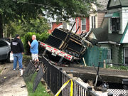 Neighbors describe 'boom,' 'roar,' as big rig plowed into cars, houses