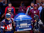 Superhero pallbearers at funeral for 8-year-old with rare heart condition
