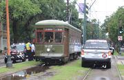 Woman falls in front of streetcar after 'medical event,' is briefly trapped