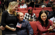 Springfield welcomes 210 new citizens with naturalization ceremony at American International College