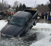 Underwater towline used to pull pickup truck from frozen Lake Huron harbor