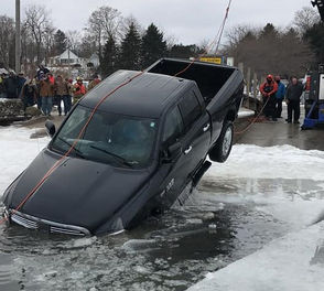 The truck was towed under the ice towards a launch ramp until the water was too shallow to tow under the ice. Personnel then cut a massive hole in the ice and the truck was towed onto the boat launch ramp.