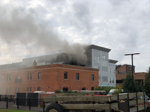 Smoke billowed from buildings at the intersection of East Michigan Avenue and South Pitcher Street Friday, Sept. 28.