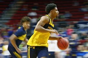 Michigan guard David DeJulius (0) runs a drill during their open practice at Wells Fargo Arena in Des Moines, Iowa on Wednesday, March 20, 2019. (Mike Mulholland | MLive.com)