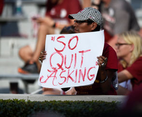 Superfan Benjamin Smith with a sign referencing Nick Saban's viral post-game interview with ESPN's Maria Taylor.