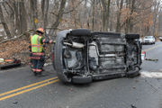 Rollover wreck sends driver to hospital (PHOTOS)