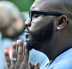 People respond to recent violence with a prayer vigil in Syracuse, NY