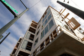 """Portland might alter a key policy designed to create more affordable housing throughout the city. City housing officials are proposing big changes to a year-and-a-half-old program known as """"inclusionary housing."""" The approach requires developers to include rent-restricted units in large housing developments, which the city hopes will create a pipeline of affordable apartments in some of the city's most desirable neighborhoods. But the Housing Bureau has recommended a delay for a scheduled increase in the number of affordable units required, and its leaders are weighing bigger tax breaks to developers in an attempt to get more apartments built. The move doesn't signal that the program isn't working, said Matthew Tschabold, the bureau's assistant director. One worry when the city adopted it was that it might restrict construction, a byproduct that could leave renters with fewer choices and drive up rents. """"From our perspective it still is too soon to tell,"""" Tschabold said. """"This is just the Housing Bureau doing what we committed to doing, which is to actively manage the program, to bring back refinements and adjustments as needed."""""""