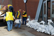 MBTA lays down sand bags in front of Aquarium Station, shuts down Friday ferries in advance of Nor'easter