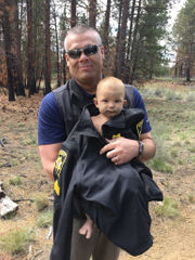 Father accused of abandoning baby in woods apprehended in Bend