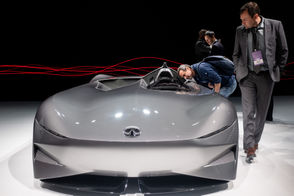Guests peer inside the Infiniti Concept 10 at the 2019 North American International Auto Show at Cobo Center in Downtown Detroit Monday, Jan. 14, 2019.