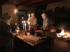 STATEN ISLAND, N.Y. -- As the sun slipped behind Lighthouse Hill and a thin layer of ice formed on Richmond Creek, hearths fired up to roast Dutch recipes and warm bodies as revelers sang holiday carols.