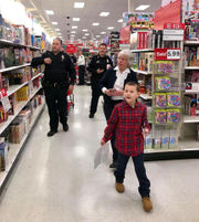 Central New York cops, firefighters take dozens of children shopping this weekend