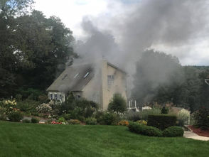 Firefighters are on the scene of a fire in a single-family house on Highland Avenue in Monson.
