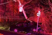 Driver not badly hurt as car crashes through utility pole (PHOTOS)