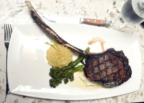 Exhibit A on how Stone's is a far departure from the building's previous tenant: This 32-ounce tomahawk ribeye steak ($68) that judge Mike Foster ordered. It doesn't get more American than a two-pound slab of meat named after a weapon.