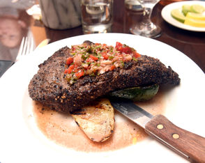La Parrilla is an intimate space with a bar and a few tables in the front of the restaurant and a larger dining room toward the rear. It's comfortable--you'd feel just as much at home with a glass of wine and a small plate at the bar as you would with a group of diners celebrating a special event in the rear dining room. Most entrees range in price from $17 to $20. At $25, our steaks were the most expensive entree on the menu and like all the entrees, included our choice of house salad or soup of the day. All four steaks were cooked to the requested doneness. The chef was even able to nail my request for rare/medium-rare, which was a touch more done than judge Charlie Miller's rare steak and less done than judges Mike and Lynda Foster's medium-rare steaks. Well done. See more photos from La Parrilla