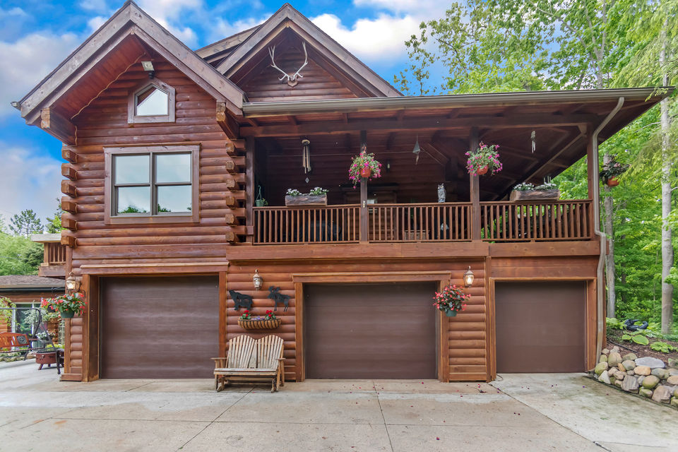 Ski lodge-type log cabin Michigan home has pool with